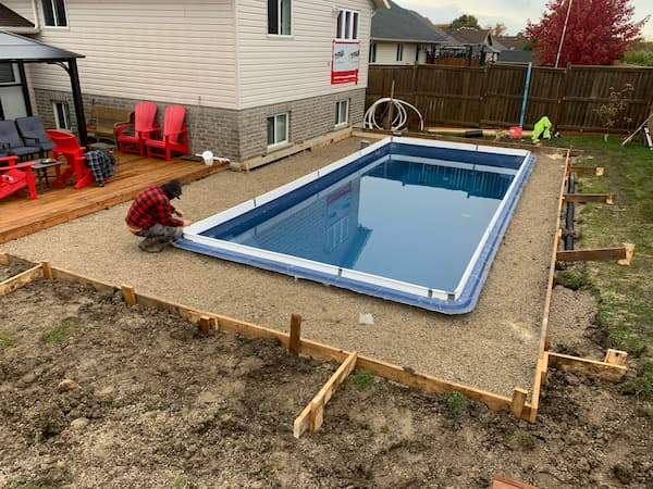 A square fiberglass pool installation in progress