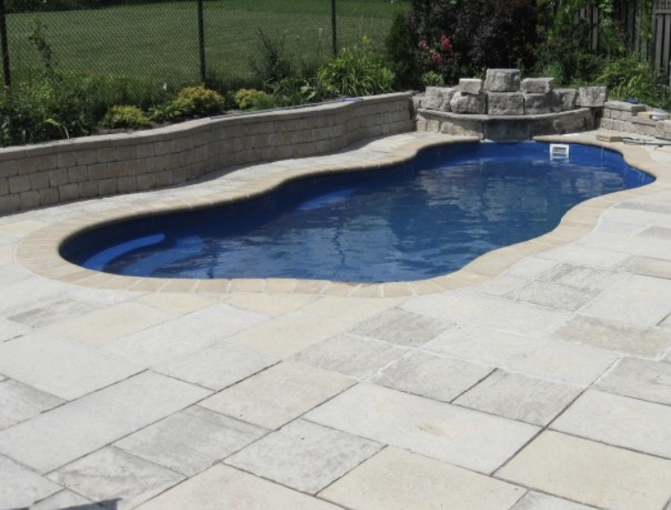 Fiberglass pool in a backyard