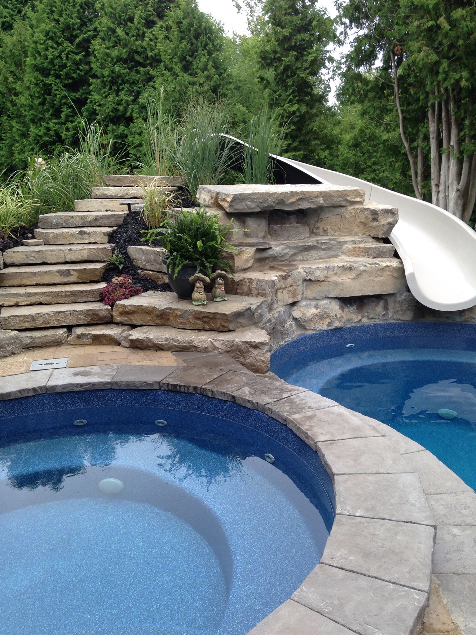 Fiberglass pool with a slide in Barrie, Ontario